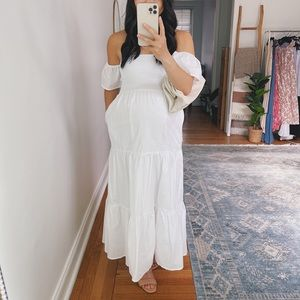 White smocked maxi dress with flutter sleeves